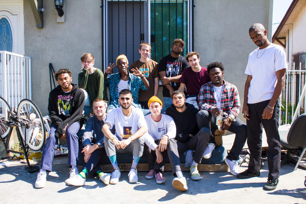 """BROCKHAMPTON, """"the best boy band since One Direction"""" sits outside of their home in East Los Angeles. Courtesy of Vice"""