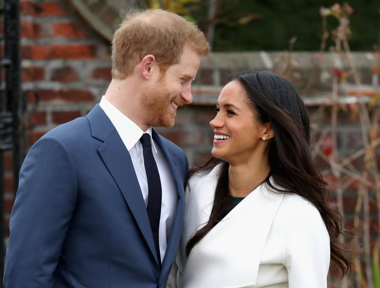 Meghan Markle and Prince Henry gaze into each others' eyes as their engagement is announced.