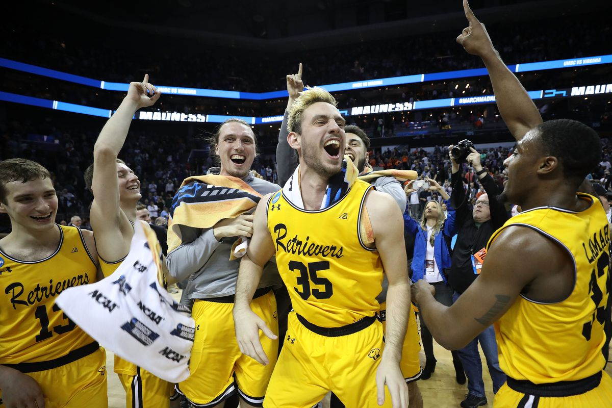 The UMBC Retrievers celebrate following their monumental round of 64 victory against number one seeded University of Virginia (photo courtesy of Streeter Lecka/Getty Images)