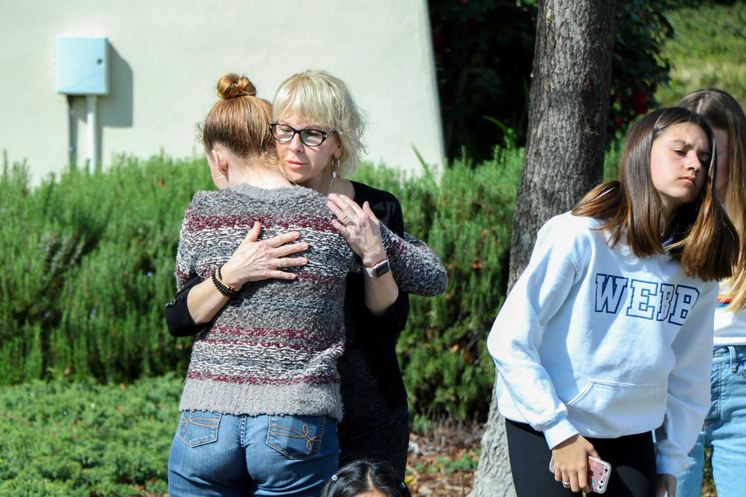 Georgia Newman ('18) embraced by dean's assistant, Mary Tarushka, after 17 minutes of silence on March 17, 2018, one month after the Parkland shooting.