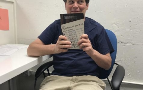 Mr. Rogers holds up a copy of his book!