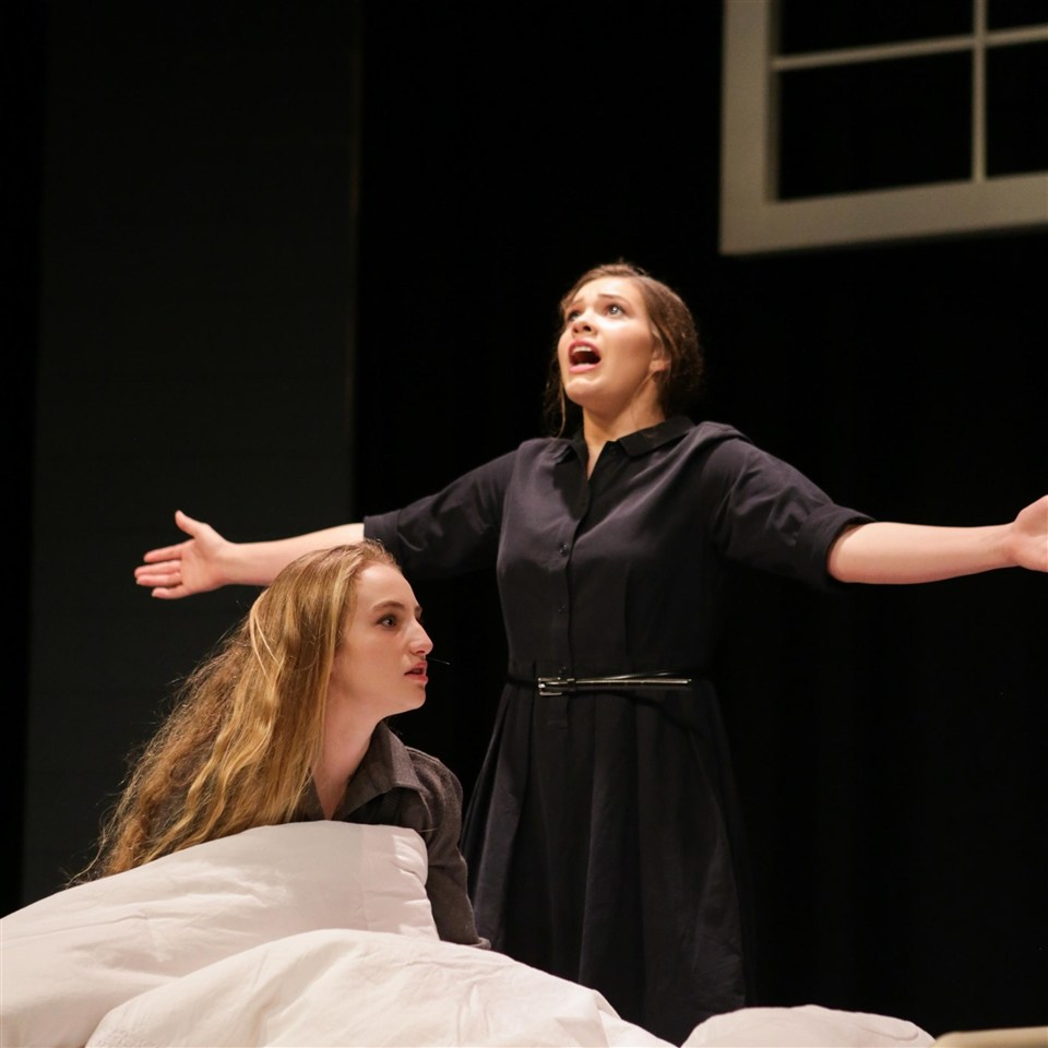 Hannalise Davidson ('20) and Molly Mitchell ('20) accuse the townspeople of witchcraft in an intense scene of The Crucible. Graphic courtesy of Ms. Plumley