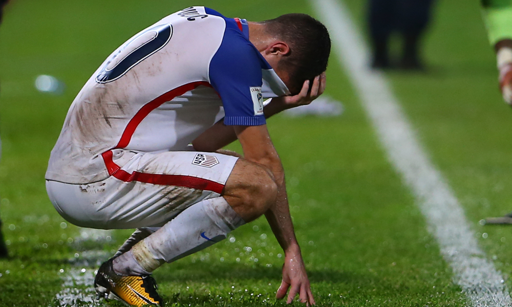 Historic Disappointment: USMNT rising star, Christian Pulisic, displays his disgust as the US misses out on the 2018 World Cup. Graphic courtesy of Getty Images