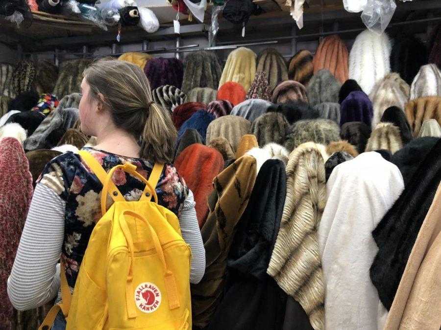 Fashionistas investigate retail sale of fabrics in the LA Fashion District in Compose Yourself!