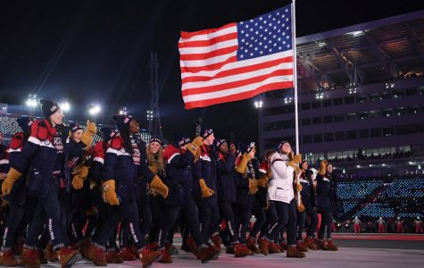 Team USA carries the American Flag at the opening ceremony of the PyeongChang Winter Games.