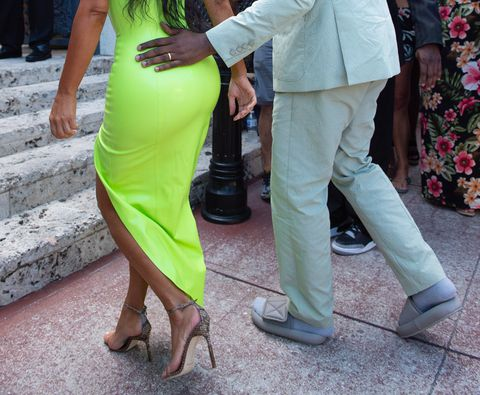 Kanye West struts in too-small sandals at 2Chainz's wedding. Graphic courtesy of Splash News.