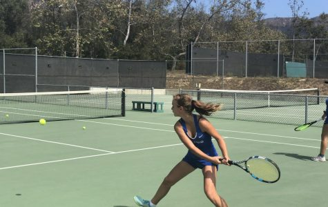 Mariia Lykhtar ('22) hits a backhand cross court during warm-up.