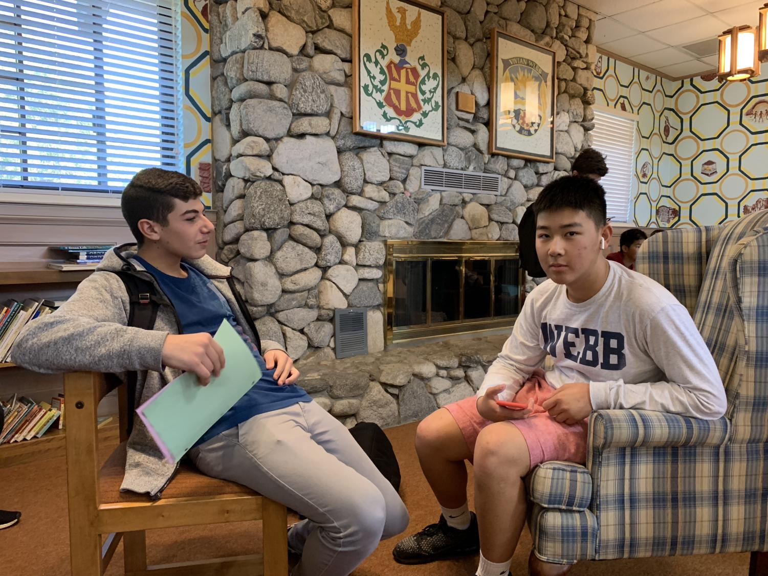 Richard Alrachid ('22) and Brian Yeung ('22) talk while wearing AirPods.