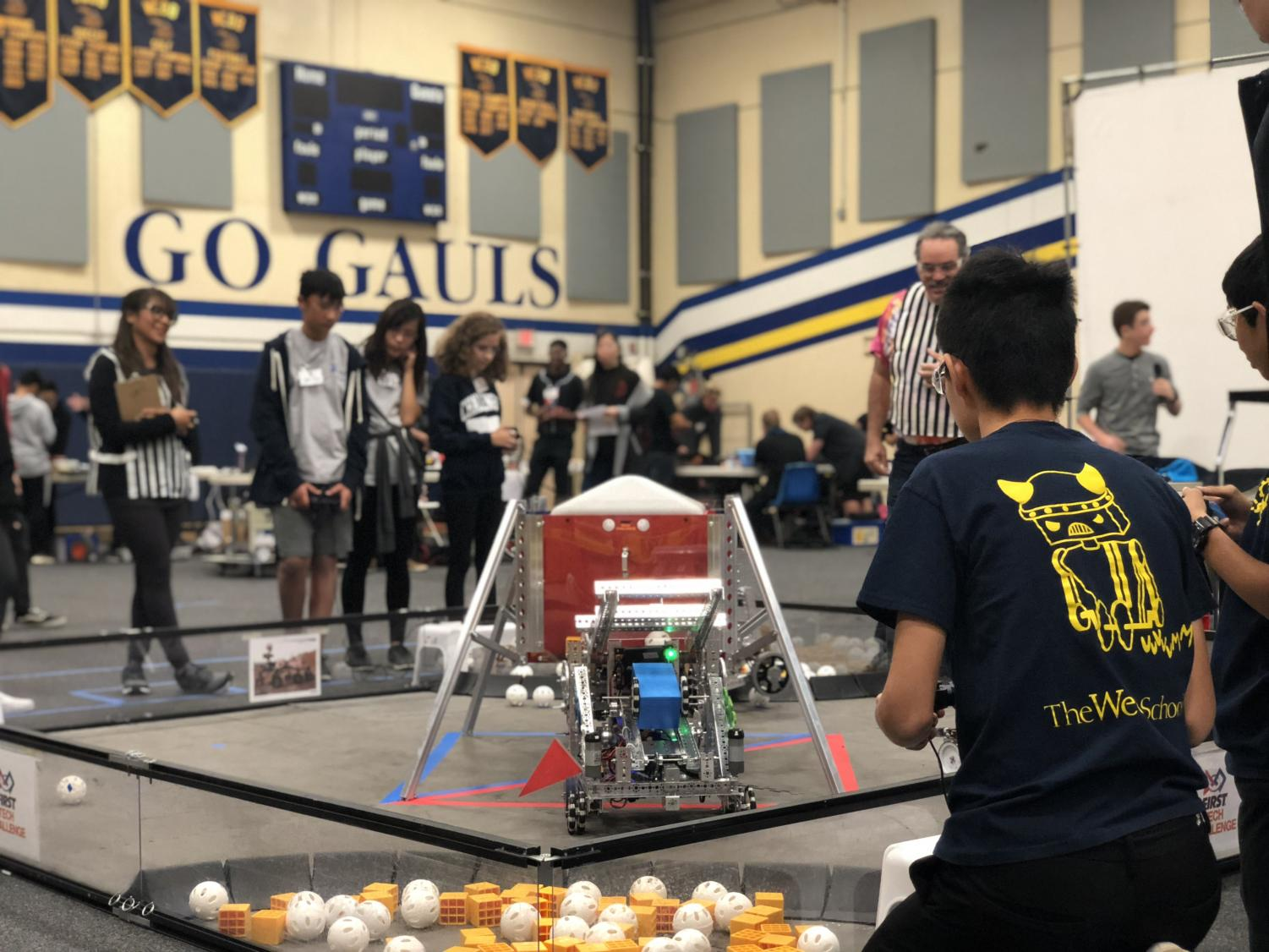 Driver Jimmy Feng ('21) controls the robot during a 150-second challenge.
