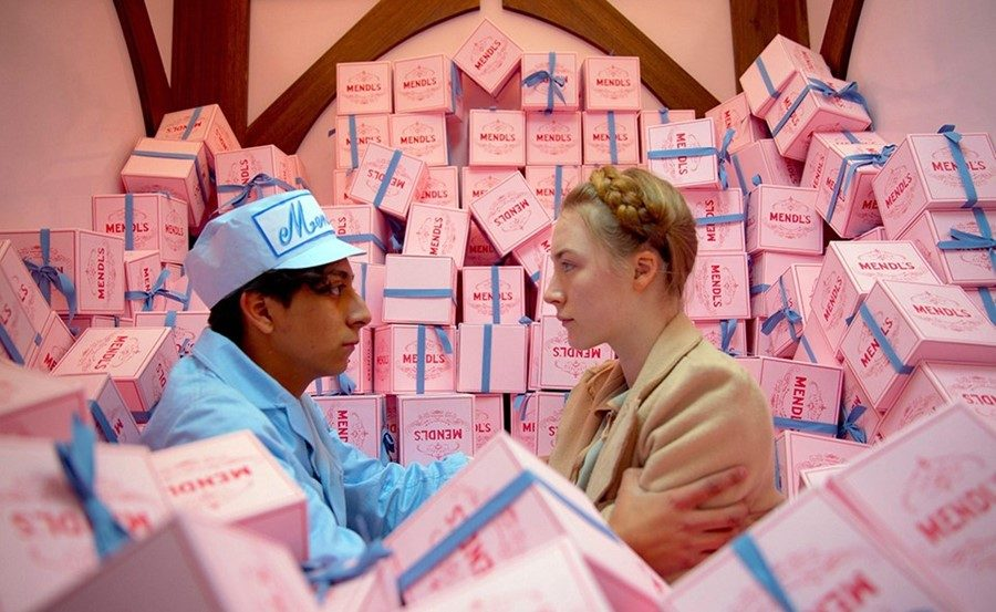 Saorise ronan and tony revolori escape with Mendl's boxes in the Grand Budapest Hotel.