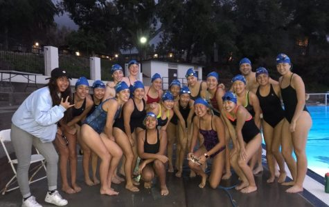 VWS water polo girls huddle together after completing the 'hour (53 minutes) of power.'