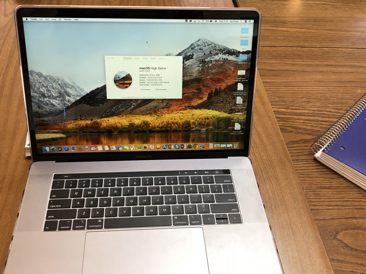 The+Mac+with+the+full+keyboard+and+touch+bar+showing+%0A