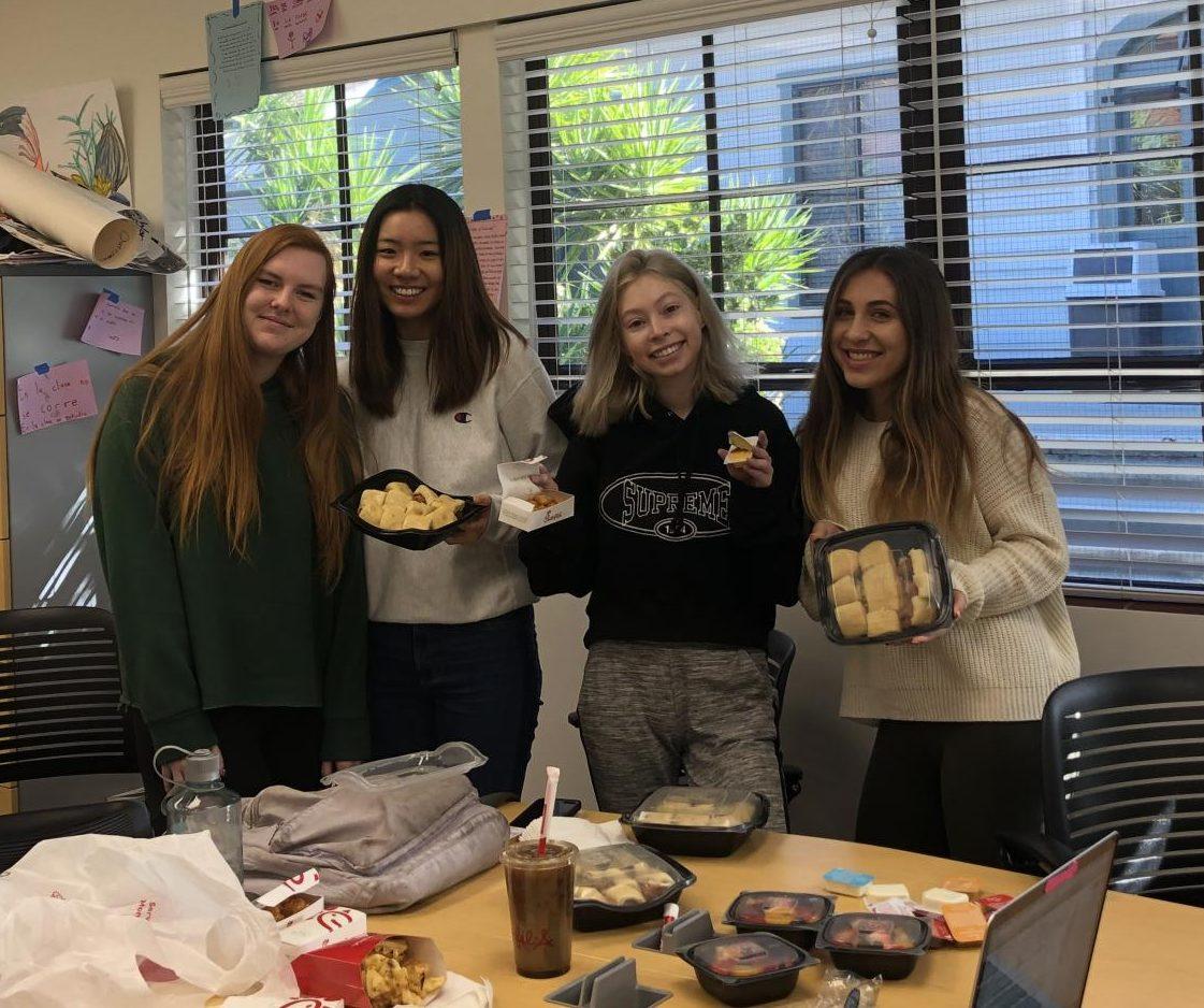 An advisory full of seniors dine on Chik-fil-a.