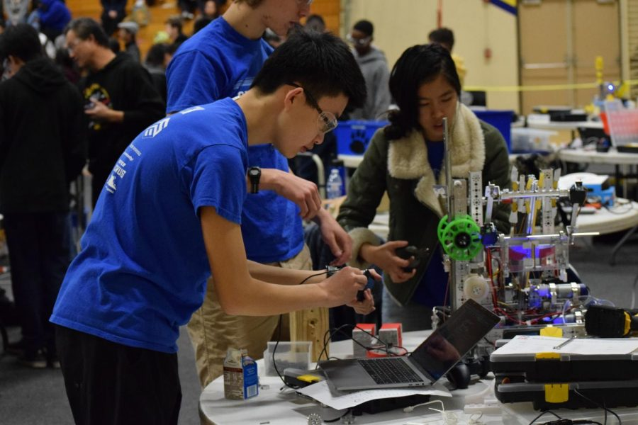 Calvin Xu ('21) is tweaking the Gaulbots' robot in between matches. A large part of robotics is trial and error and learning how to rebound from unexpected obstacles. His team of more experienced programmers, mechanics, and drivers placed 3rd out of 13 in this tournament.