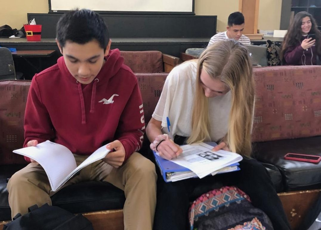 Lily Miller ('21) and Brandon Martin ('21) work on homework before school.