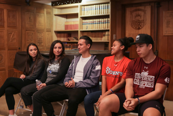 Alumni return to answer student's questions about college athletics