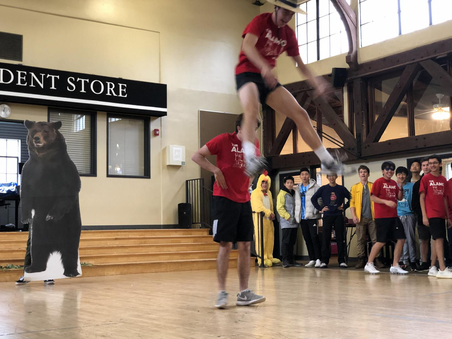JP Calderoni ('19) and Willy Martinez ('19) perform a stunt in the middle of the Alamo dance.
