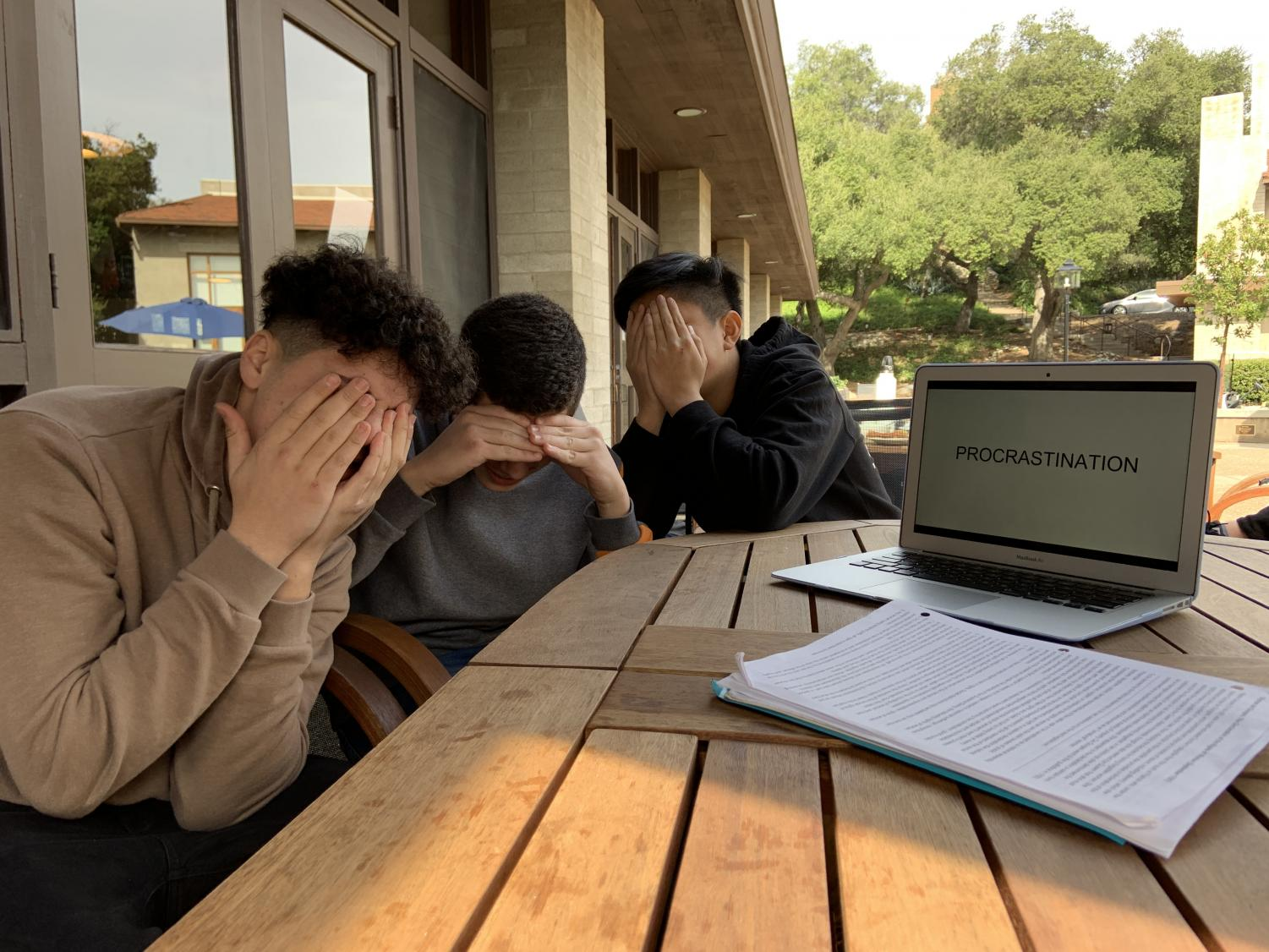 Xander Kong ('22), Dillon Anabi ('22), and Richard Alrachid ('22) procrastinate  at the dining hall.
