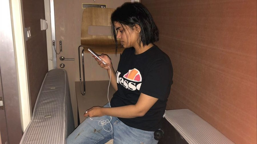 Rahaf Mohammed checks her twitter in her hotel barricade. Graphic courtesy of Teen Vogue.