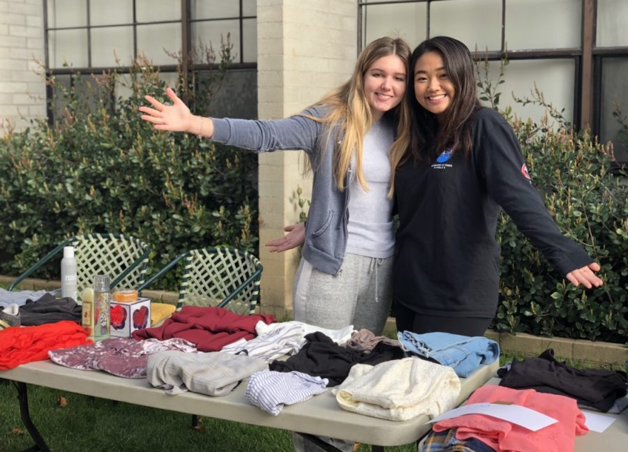 Jones dorm prefects Victoria Mirzayants ('19) and Doris Yuan ('20) pose for a picture in between helping with sales.