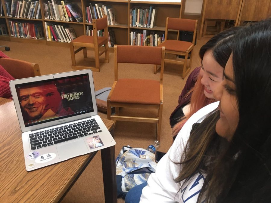 Ava Sinha ('20) and Renny Jiang ('20) watch the thrilling true crime documentary, Conversations with a Killer: The Ted Bundy Tapes, together in the library.