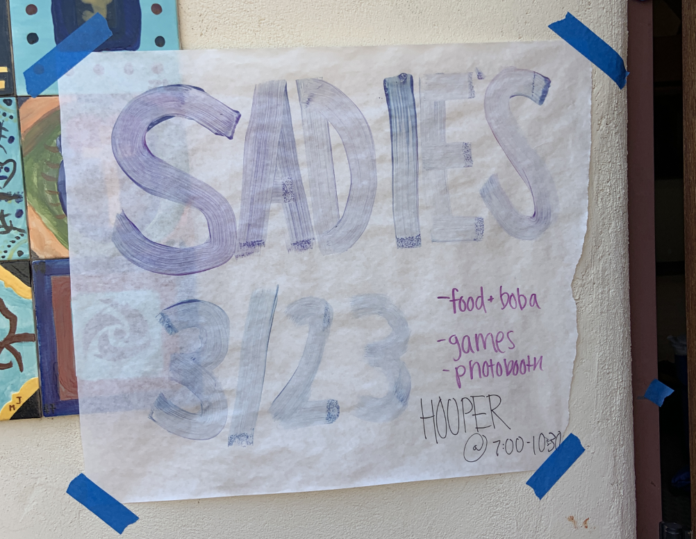 The sophomore class creates posters for the Sadie's Dance.