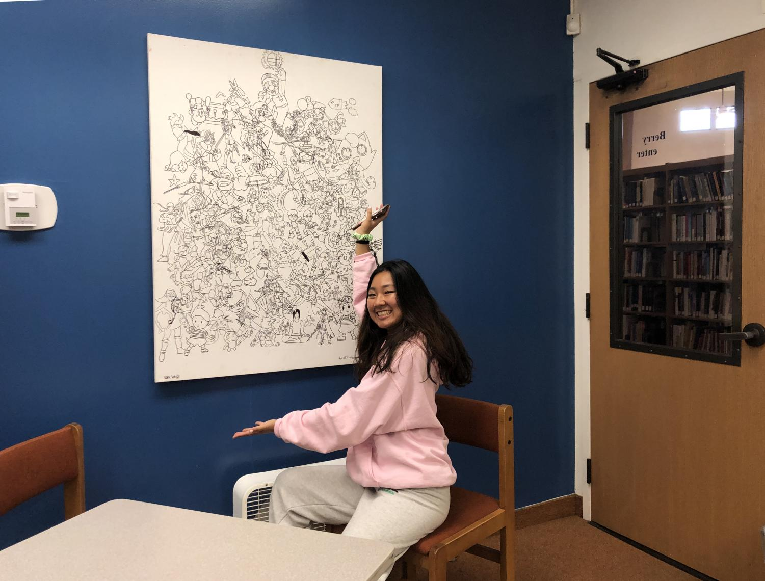 Kara Sun ('20) proudly showcases her new piece,