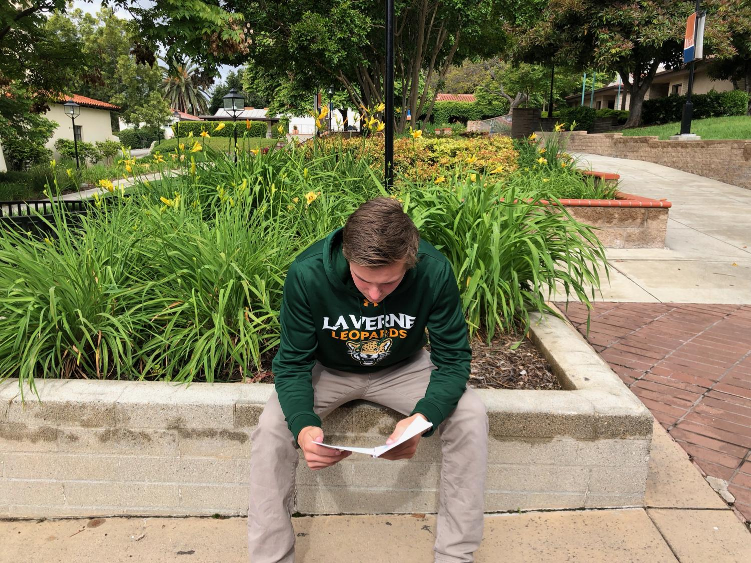 Eric Evans ('19) reads the student handbook.