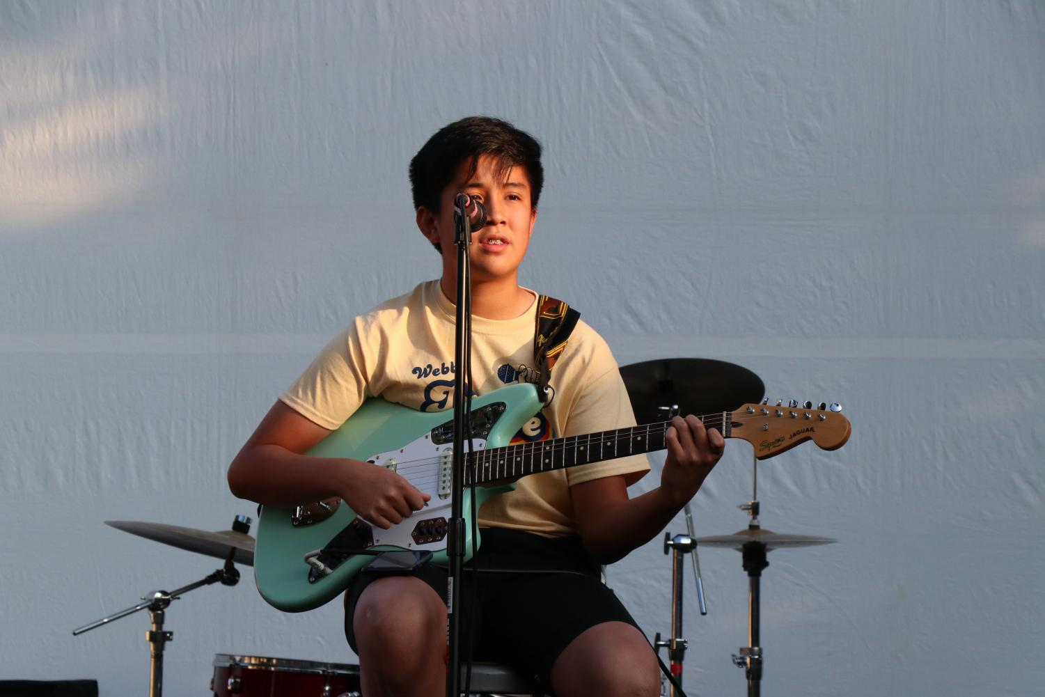 Xander+Kong+%28%2722%29+plays+the+guitar+and+sings.+