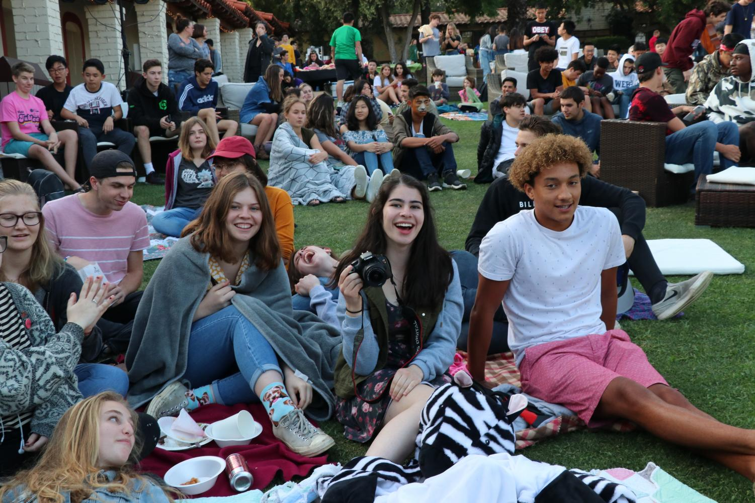 Students+enjoy+their+set-up+on+the+lawn.+