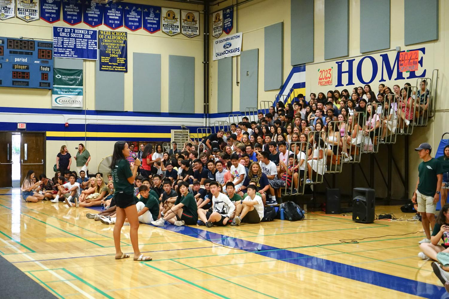 Sydney Wuu ('20), VWS All-School President, introduces the activities to students and faculty while the underclassmen wait excitedly for the games.