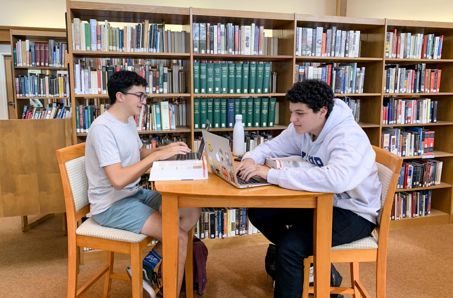 Hunter Lange ('22) and Dillon Anabi ('22) productively spend their Free Block getting ahead on homework.