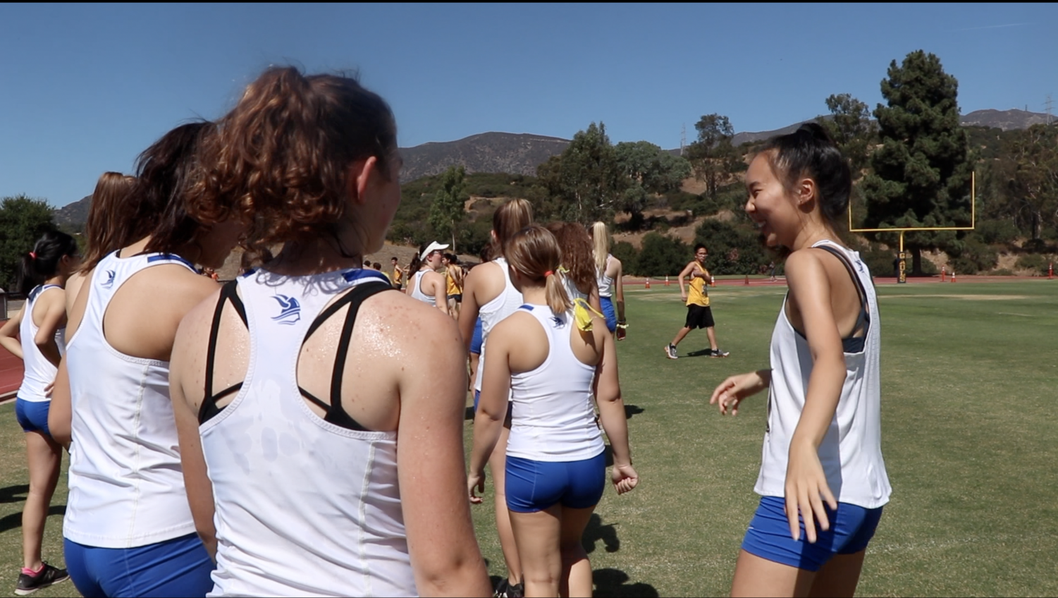VWS varsity cross country runners make their ways towards the starting line.