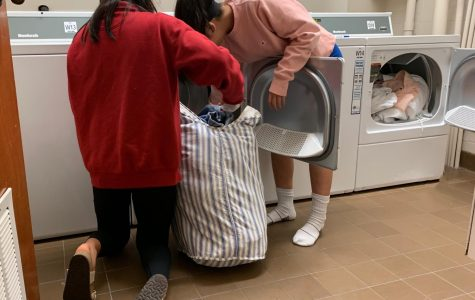 Jones residents Sara Hagiwara ('20) and Sydney Wuu ('20) do their laundry with the new laundry facility.