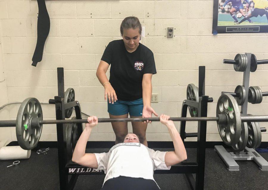 Julia+Patronite+%28%E2%80%9821%29+spots+Livia+Hughson+%28%E2%80%9821%29+in+bench+press+as+she+tries+to+become+a+stronger+swimmer.