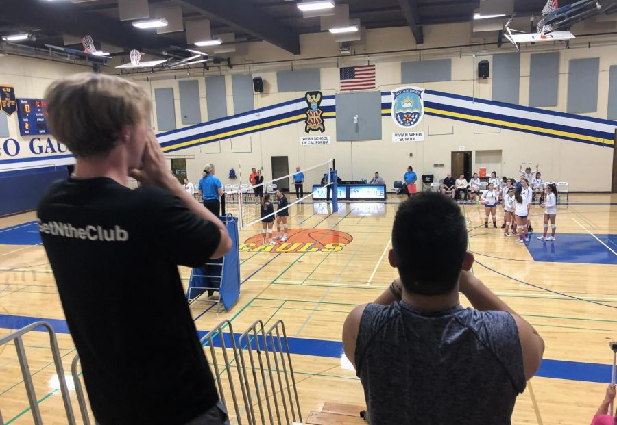 Cayden+Lazier+%28%E2%80%9820%29+and+Stephen+Li+%28%E2%80%9821%29+cheer+on+the+VWS+varsity+volleyball+team+at+their+league+championship+game.%0A