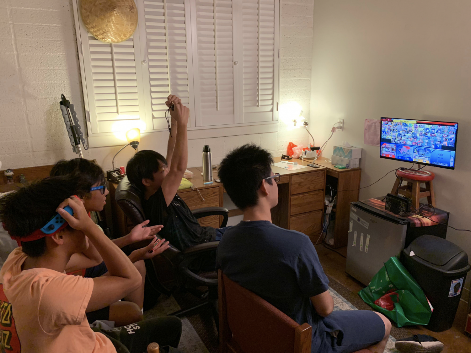 Winston Li ('21), Matthew Gaw ('21), Jonathan Zhang ('21), and Leo Cheng ('21) all gather around for a game of Super Smash Bros!