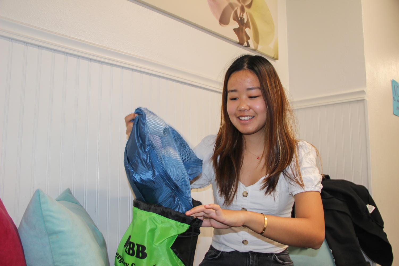 Ashley Fu ('20) packs her emergency go bag in case of potential fire emergencies.