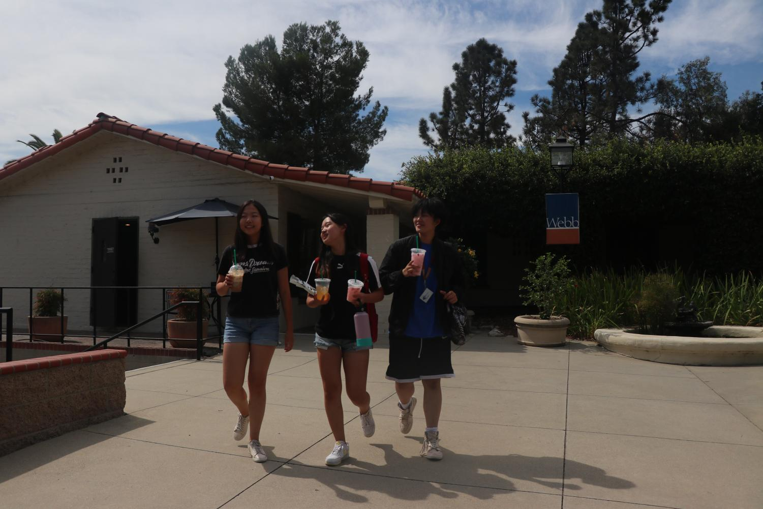 After a mid-week Target run, Fiona Jiang ('22), Jojo Jiang ('22) and Brandy Zhang ('22) walk around campus holding Starbucks drinks.