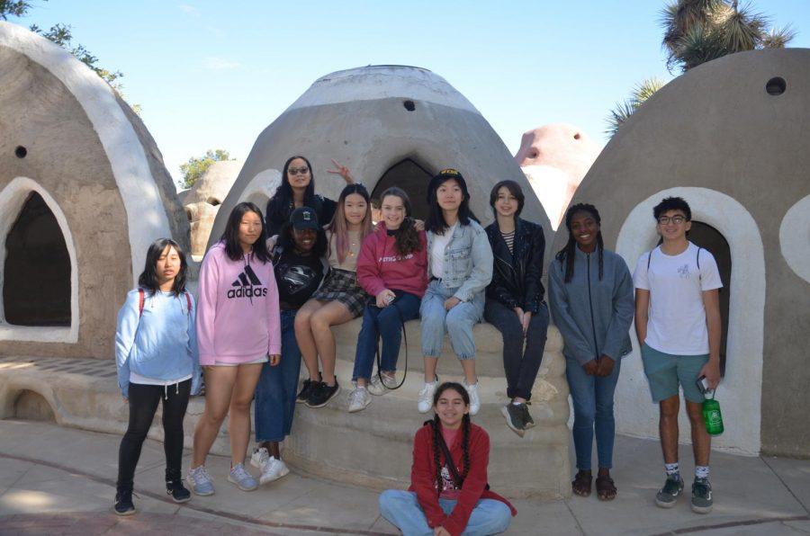 Webbies+pose+in+front+of+SuperAdobe+structures.%0A