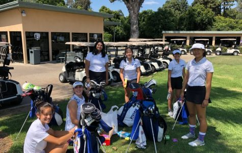 The VWS golf team smiles at a competition.