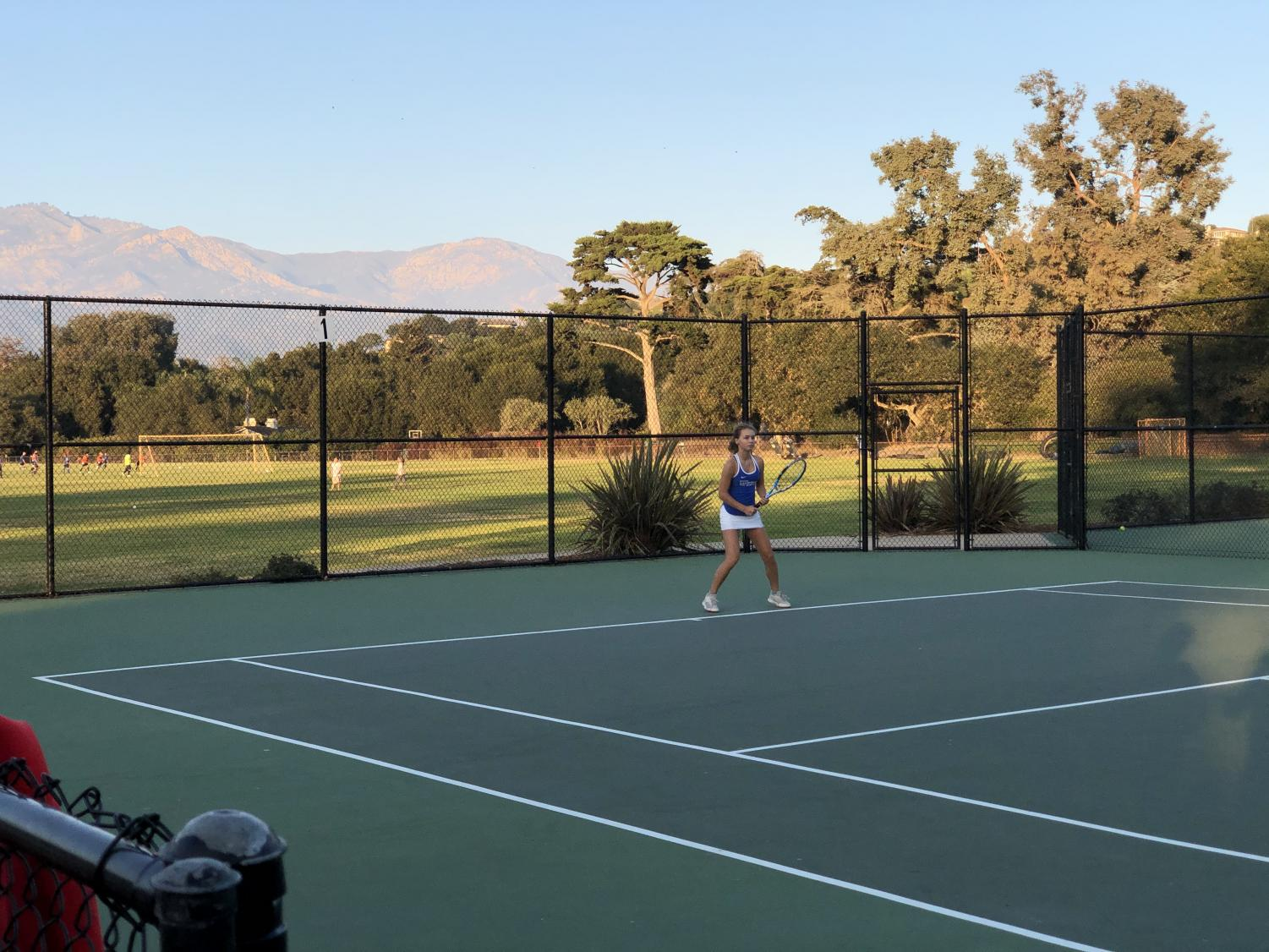 Mariia Lyktar ('22) prepares to hit a forehand down-the-line shot from the baseline.