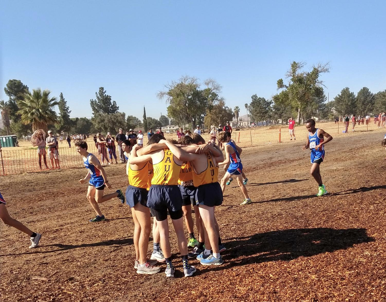 Runners cuddle before racing.