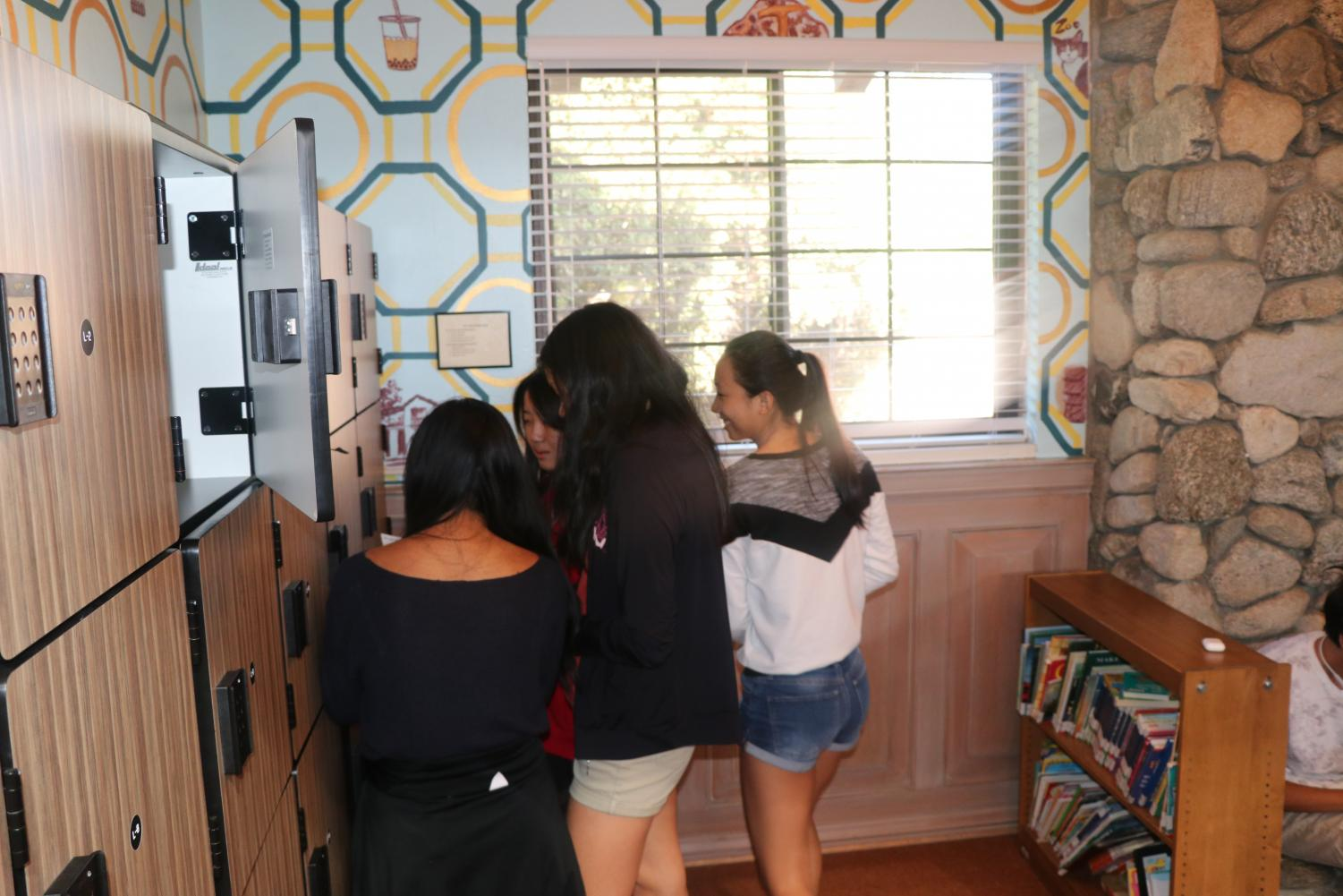 Nina Luo ('22), Leeann Shu ('22), Haley Colorado ('22), and Nancy Li ('22) just beginning their game at the library lockers.