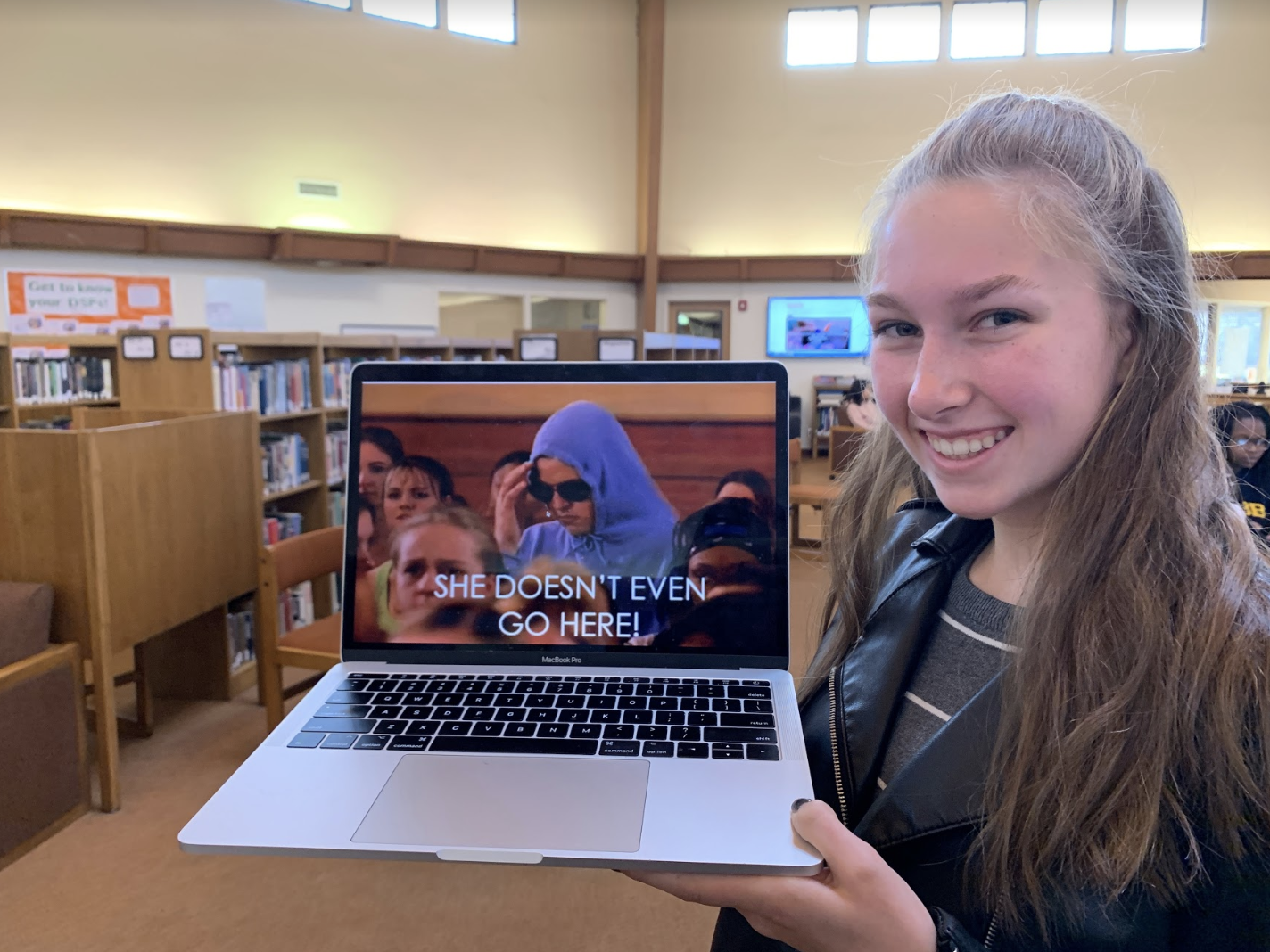 Ashley Cox ('21) poses with the meme she wore on meme day.