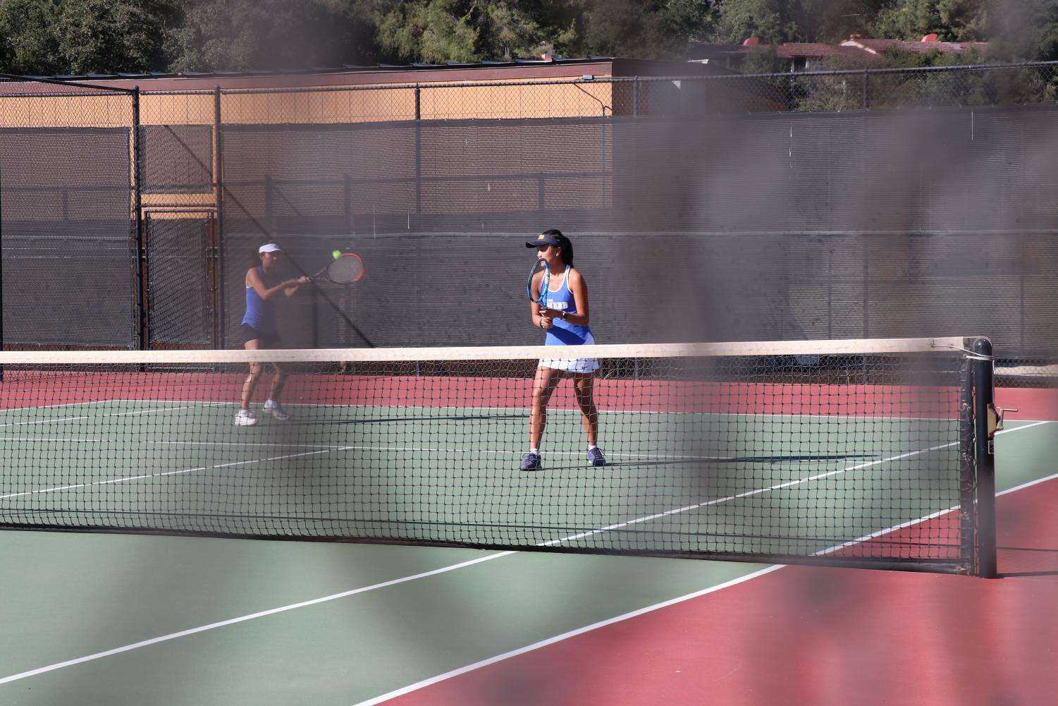 Sydney Wuu ('20) stands ready as Kara Sun ('20) hits the ball towards the teams' Sage Hill opponents.