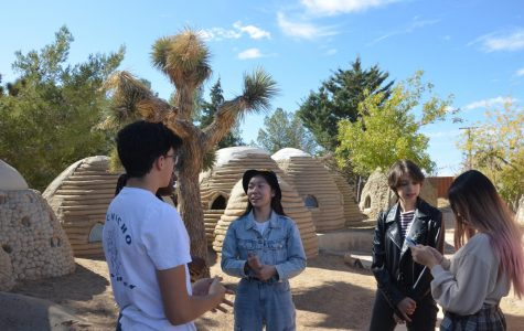 Webbies converse at the California Institute of Earth Architecture while surrounded by models of SuperAdobe structures.