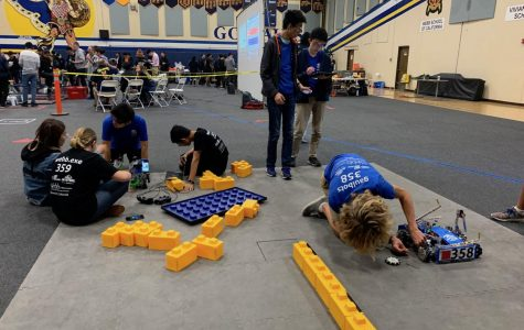 The Webb robotics teams finalizing their robots before the competition begins.
