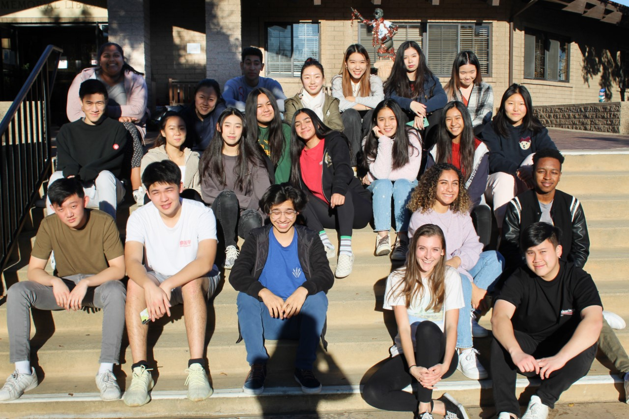 The yearbook staff poses outside of Fawcett Library.