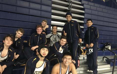 Wrestlers pose for a picture at the start of the tournament.